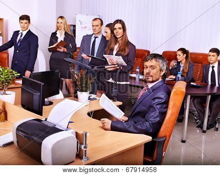 Happy group business people with chart in office.