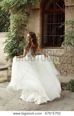 Happy Bride Woman Running In Wedding Dress At Park, Outdoors Portrait