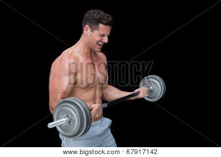 Shouting crossfitter lifting up heavy barbell on black background