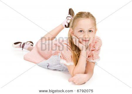 Little Girl Lying On The Floor