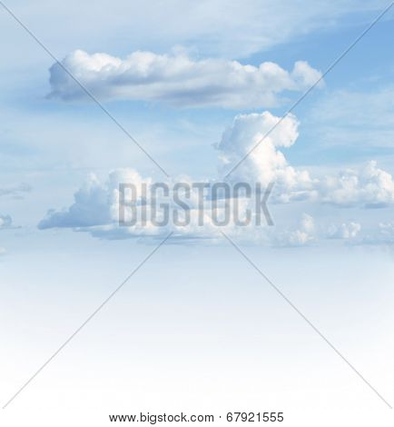 Fluffy white clouds in sky