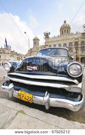 Old Car Parked In Front Of The Revolution Museum In Havana, Cuba