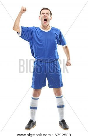 Soccer player standing and screaming