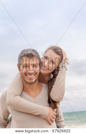 carefree smiling couple at the coast