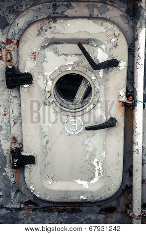 Old Gray Ship Door With Porthole And Handles