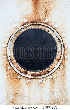Round Rusted Porthole On White Ship Wall