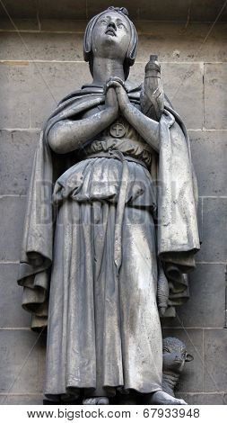 PARIS, FRANCE - NOV 09, 2012: Saint Genevieve, architectural details of Eglise de la Madeleine. Madeleine Church was designed in its present form as a temple to the glory of Napoleon's army.
