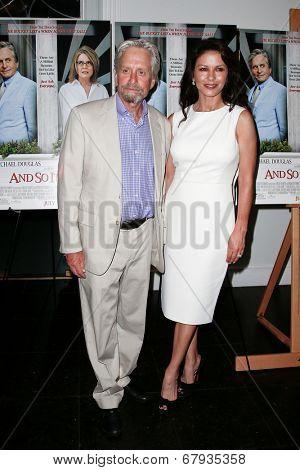 EAST HAMPTON, NEW YORK-JULY 6: Actors Michael Douglas (L) and Catherine Zeta-Jones attend the premiere of