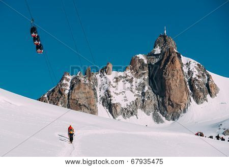 CHAMONIX - JUNE 21: The Aiguille du Midi peak with Panoramic Mont-Blanc cable car on june 21, 2014 in Chamonix, France.