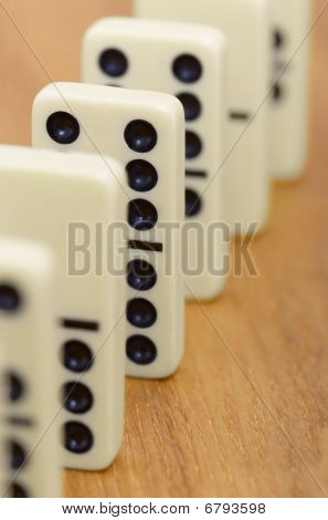 Dominoes On Wooden Surface Abreast
