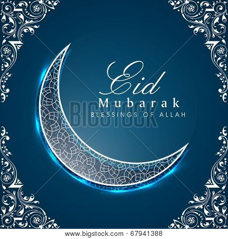 Shiny crescent moon on floral decorated blue background for the occasion of Muslim community festival Eid Mubarak celebrations.