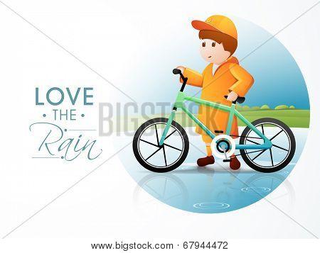 Cute little boy wearing yellow raincoat ready for cycling on beautiful monsoon season.