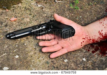 Murdered man with a gun