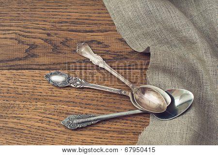 vintage tea spoons on wooden background