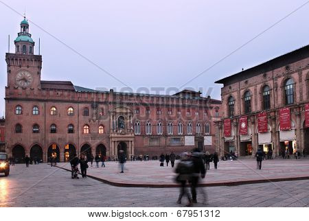 BOLOGNA, ITALY - JANUARY 12, 2013: People on the Piazza Maggiore against the Palazzo d'Accursio, or Palazzo Comunale. Built in Middle Age, now it houses the Civic Art Collection and the Museo Morandi