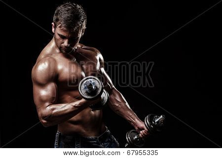 athletic young man on black background