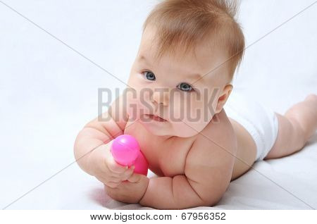 Baby Playing And Holding Skittle For Bowling