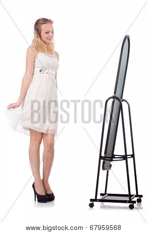 Woman with mirror trying new clothing