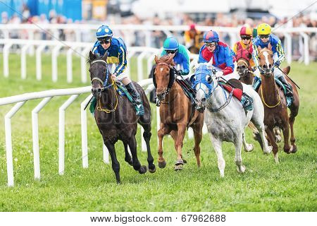 Group Of Jockeys Out Of The Fourth Curve At The Nationaldags Galoppen In Gardet