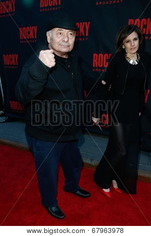 NEW YORK-MAR 13: Actor Burt Young (L) and Lisa Scuteri attend the 'Rocky' Broadway opening night at the Winter Garden Theatre on March 13, 2014 in New York City.