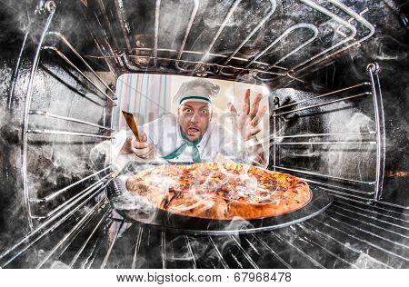 Funny chef overlooked pizza in the oven, so she had scorched, view from the inside of the oven. Cook perplexed and angry. Loser is destiny!