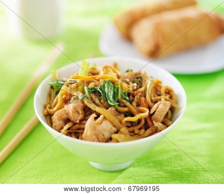 chinese chicken lo mein in a bowl