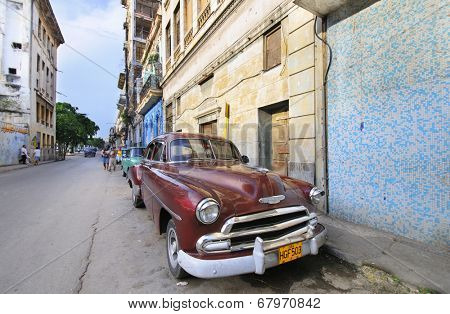 HAVANA, CUBA - JULY 9, 2010.  Vintage classic American car, commonly used as private taxi parked in Havana street.