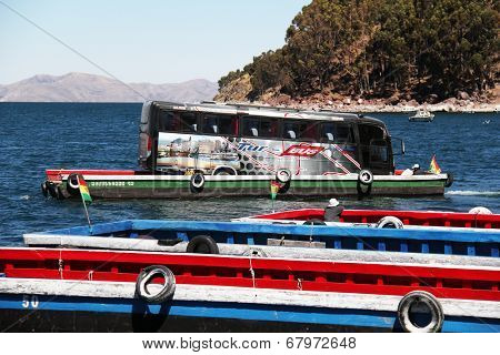 Tiquina, Bolivia - September 28, 2010: Bus crossing lake Titicaca on a raft while passangers take the boat