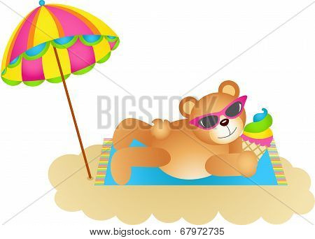 Teddy bear soaking up the sun on a beach