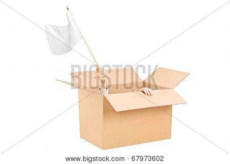 Man waving a white flag hidden in a carton box isolated on white background