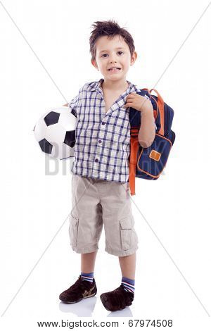 Full body portrait of happy school kid holding a soccer ball, isolated on white background