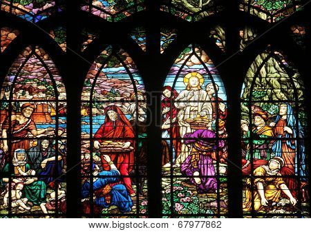 PARIS, FRANCE - NOV 09,2012:Feeding 5000 men and their families, stained glass.Church of Saint-Jean-de-Montmartre situated at the foot of Montmartre.Built from 1894 through 1904, Nov 09, 2012 in Paris