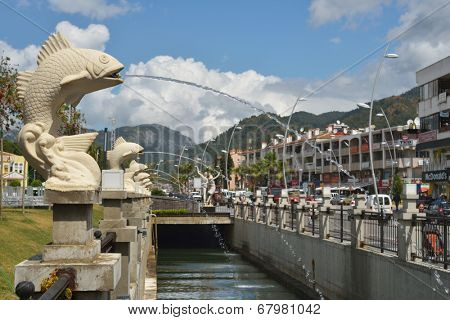 MARMARIS, TURKEY - APRIL 18, 2014: Fountains and canal along the Ulusal Egemenlik Avenue. Population of Marmaris, formerly small fisherman's village, increases 10 times during the tourism season