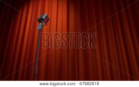 3d retro microphone on red curtain background, low angle view