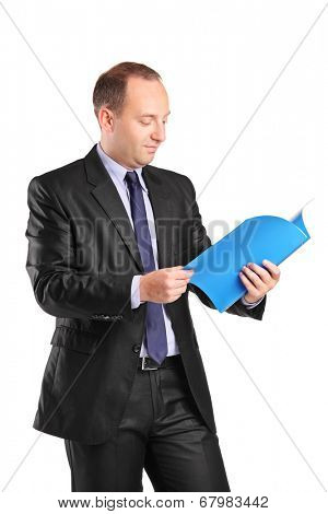 Vertical shot of a businessman reading a document isolated on white background