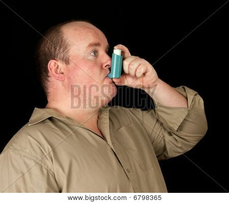 Male With Inhaler Asthma On Black Background