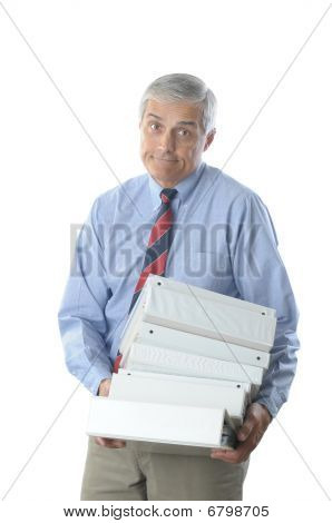 Overworked Middle Aged Businessman With Stack Of Books