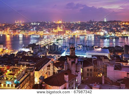 ISTANBUL, TURKEY - MARCH 12, 2014: Night view to Golden Horn bay and Galata bridge. Built in 1992, the bridge is now a place where the locals gather to fish, eat, drink, smoke and shop