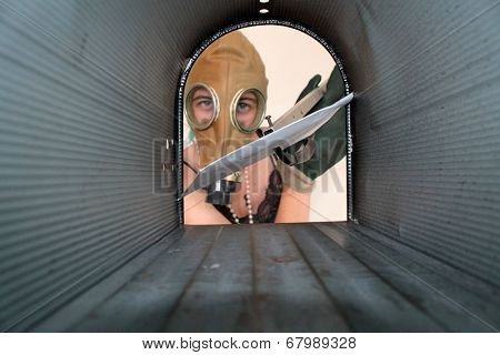 A young woman wears a Gas Mask to Send or Retrieve her mail. This concept represents a