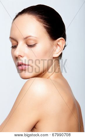 Perfect woman posing for camera over white background