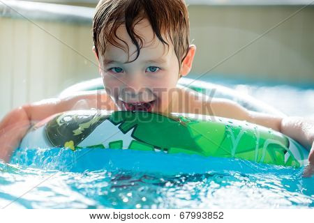Boy in inflatable ring having fun