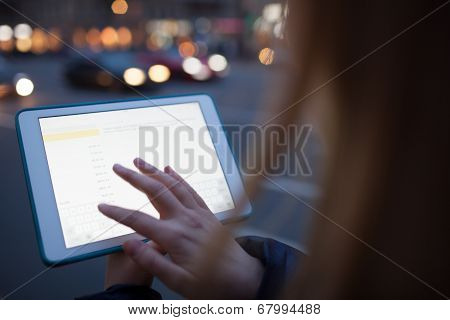 Woman touching tablet screen