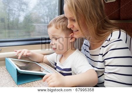 Mother and her young son on a train