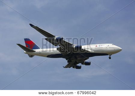 Delta Airline Boeing 747 in New York sky before landing at JFK Airport