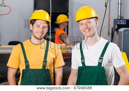 Factory Workers At Production Area