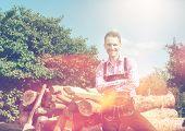 stock photo of lederhosen  - Handsome guy in Lederhosen posing outside in nature - JPG