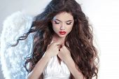 pic of hair curlers  - Attractive Beautiful Angel Girl model with wavy long hair studio portrait - JPG