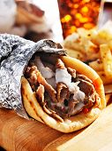 stock photo of shawarma  - gyro with tzatziki sauce - JPG