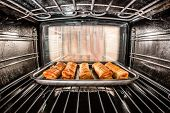 stock photo of oven  - Baking pastry in the oven - JPG