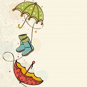 stock photo of rainy season  - Stylish rainy season concept with colourful umbrellas and boots on beige background - JPG